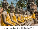 aligned buddha statues at wat... | Shutterstock . vector #174656015