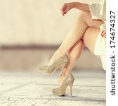 legs of woman and street  | Shutterstock . vector #174674327