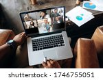 Small photo of Video call. Online business meeting. Business colleagues communicate by a video conference using a laptop, discussing about business affairs. On a laptop screen, participants of a video conference