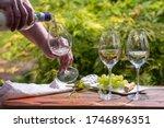 Pouring Of Pinot Gridgio Rose...