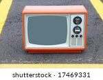 Vintage TV on a parking lot - stock photo