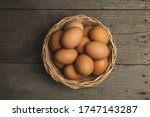 Eggs In Basket On Wooden Table...