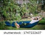 A man is resting in a hammock...