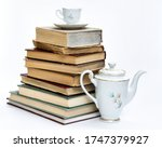 A Stack Of Old Books And An...