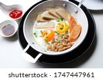 close up pan fried egg with...