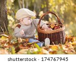 happy child in warm clothes is... | Shutterstock . vector #174767945