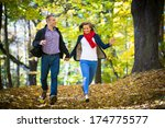 young woman and man running in... | Shutterstock . vector #174775577