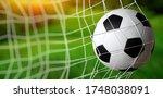 soccer ball in goal on grass   Shutterstock . vector #1748038091