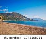 Amazing Adriatic sea landscape, sandy beach and coastline of Adriatic sea, Montenegro, sunny day at blue sky background - stock photo