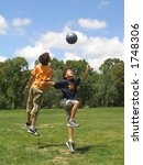 two boys playing soccer in a...   Shutterstock . vector #1748306