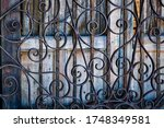 Filagree Iron Fence In Front Of ...