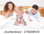 cute young family messing about ... | Shutterstock . vector #174838925