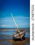 old boat on a beach | Shutterstock . vector #174875231