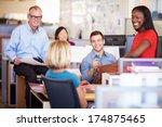 Businesspeople Having Meeting...