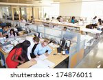 Small photo of Interior Of Busy Modern Open Plan Office