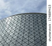 Stock photo glass rounded modern building against blue sky 174889415