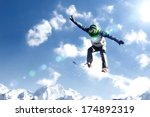 snowboarder making jump high in ... | Shutterstock . vector #174892319
