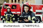 Portrait Of Two Firefighters In ...