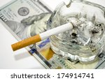 Cigarettes And Dollar As A...