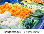 Selection of vegetables and fruit on display at a street market - stock photo