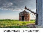 Rusty Grain Bin On Old Farm