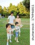 japanese family carrying... | Shutterstock . vector #174946811