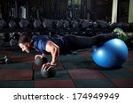man at the gym doing exercises... | Shutterstock . vector #174949949
