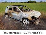 burnt out car in field. stolen... | Shutterstock . vector #1749786554
