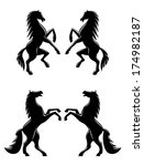 Stock vector silhouettes of two pairs of prancing rearing horses logo with flowing manes and tails in profile 174982187