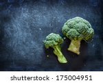 raw broccoli on black... | Shutterstock . vector #175004951