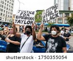 Small photo of New York, NY - June 5, 2020: Protesters gathered for memorial for Breonna Taylor killed by police on her 27th birthday at African Square on Adam Clayton Powell Jr boulevard