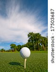 golf ball on tee at driving range - stock photo