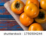 Some Persimmons Arranged On A...