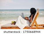 Young Woman Enjoying Sitting On ...