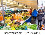 ZWOLLE, THE NETHERLANDS - FEBRUARY 1, 2014: Unidentified peope buying groceries at the street market in Zwolle. In the Netherlands there are 18,000 merchants realizing a 2.6 billion turn over. - stock photo