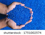 Small photo of Blue plastic grain, plastic polymer granules,hand hold Polymer pellets, Raw materials for making water pipes, Plastics from petrochemicals and compound extrusion, resin from plant polyethylene.