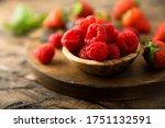 Fresh Raspberry In A Wooden Bowl
