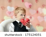 little boy with red heart in... | Shutterstock . vector #175124051
