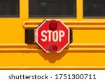 Yellow School Bus With Stop Ar...