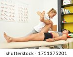young female physiotherapist... | Shutterstock . vector #1751375201