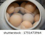 boiled eggs in a pan | Shutterstock . vector #1751473964