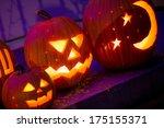 halloween jack o lanterns sit... | Shutterstock . vector #175155371