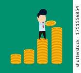 businessman arranges coins to... | Shutterstock .eps vector #1751556854