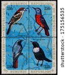Small photo of BURUNDI - CIRCA 1970: A set of four stamps printed in Burundi, shows a birds Woodchat Shrike, Common Rock Thrush, Black Redstart, Ring Ouzel, circa 1970