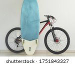 Mountain Bike And Surfboard At...