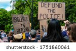 Small photo of Brooklyn, New York / USA - June 7, 2020: People in a family protest march in Brooklyn holding signs that say Defund and Demilitarize the Police