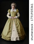 Small photo of A Tudor woman in a gold dress