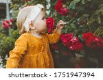 Child Girl Smelling Flowers Re...