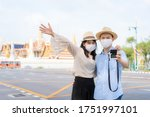 Asian Couple Happy Tourists To...