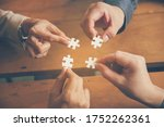 Small photo of Implementation improving connections strategy team solution organization.Piece of jigsaw assembly by Implement puzzle. Hands of team connecting group of business people solutions success strategy